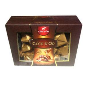 Конфеты Cote D'Or из молочного шоколада с двухслойной начинкой и вафельной трубочкой, покрытой темным шоколадом